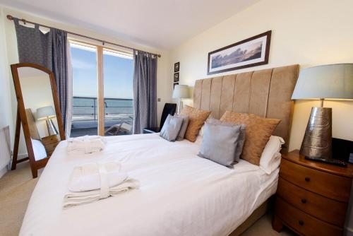 A bed or beds in a room at The Sands