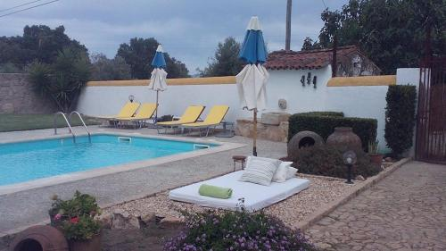 The swimming pool at or near A Flor Da Rosa