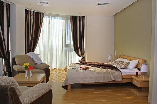 Кровать или кровати в номере Diana Palace