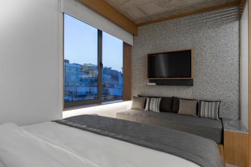 מיטה או מיטות בחדר ב-Ergon House