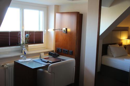 A bathroom at Adena Hotel