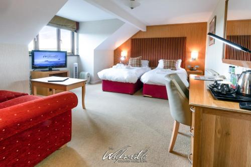 A television and/or entertainment centre at Wolfscastle Country Hotel