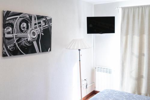 Una televisión o centro de entretenimiento en Gran Vivienda Centro Historico San Lorenzo