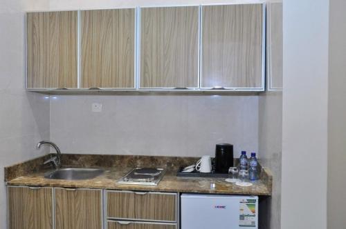 A cozinha ou cozinha compacta de بلقيس فرع الشفاء للشقق الفندقيه