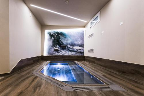 The swimming pool at or near Hotel Fiera Wellness & Spa