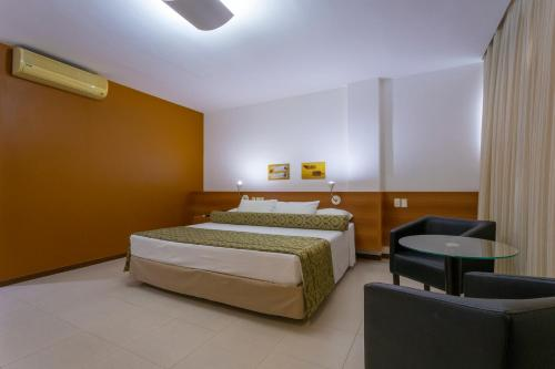 A bed or beds in a room at Hotel Serra Grande - SERRA - ES