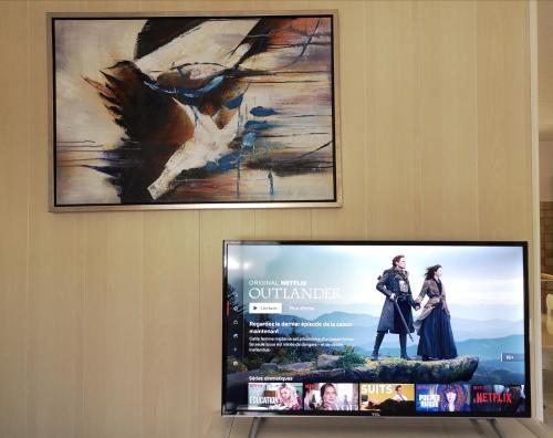 Uma TV ou centro de entretenimento em Lagoon Dream