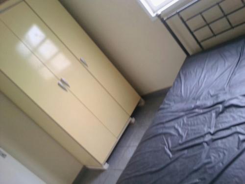 A bed or beds in a room at Apto 3 qtos Praia Jacaraípe Serra