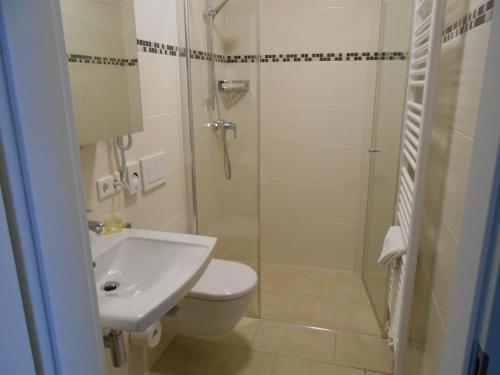 Ванная комната в Hotel Weisse Elster