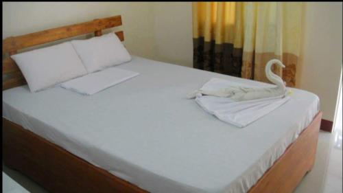 A bed or beds in a room at AJ Travellers Inn - Main