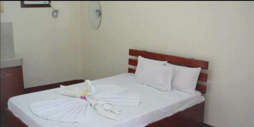 A bed or beds in a room at AJ Travellers Inn - Annex