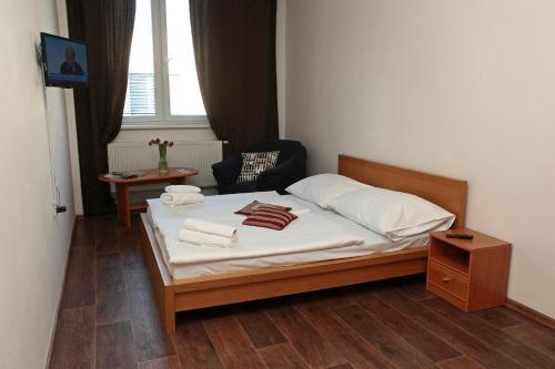 Кровать или кровати в номере Hotel Arko