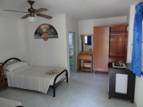 Кровать или кровати в номере Sabai Resort
