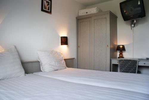 Ein Bett oder Betten in einem Zimmer der Unterkunft Fletcher Hotel - Restaurant Nieuwvliet Bad
