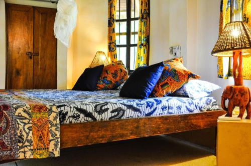 A bed or beds in a room at Ankobra Beach Resort