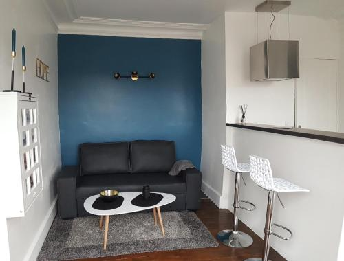 Coin salon dans l'établissement Le cœur de Troyes - Appartement