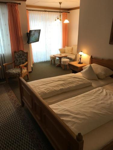 Ein Bett oder Betten in einem Zimmer der Unterkunft Landhaus Preißinger