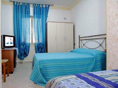 A bed or beds in a room at Affittacamere il Laghetto