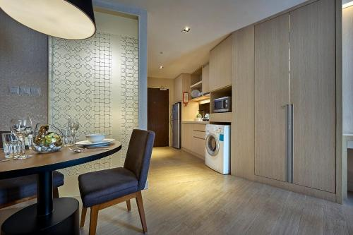A kitchen or kitchenette at Oasia Suites Kuala Lumpur by Far East Hospitality