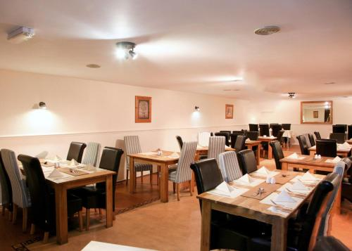 A restaurant or other place to eat at Lumb Farm Country Club