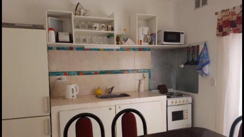 Una cocina o kitchenette en Belgrano 1030 Junin