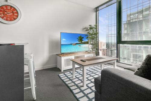 A television and/or entertainment center at Sanctuary Apartments - Wrap