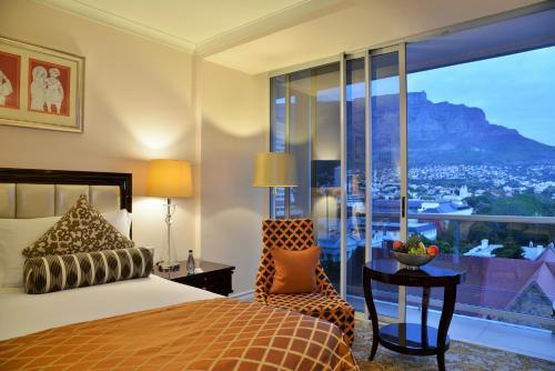 Кровать или кровати в номере Taj Cape Town