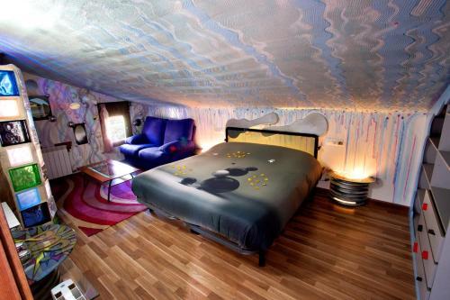 Cama o camas de una habitación en Anahuaska Art - Suites Temáticas