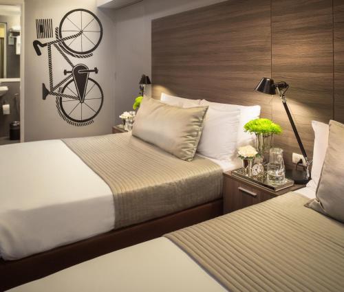 Кровать или кровати в номере Astoria Greenbelt