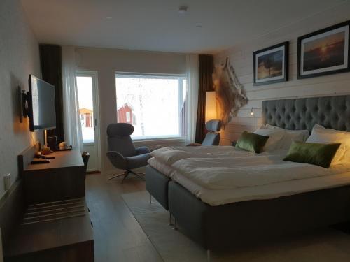 Säng eller sängar i ett rum på Kukkolaforsen Turist & Konferens