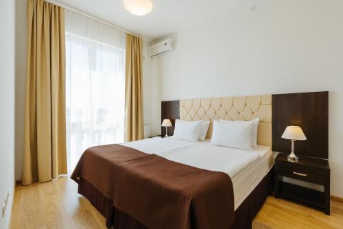Кровать или кровати в номере Апарт-отель Имеретинский - Прибрежный квартал