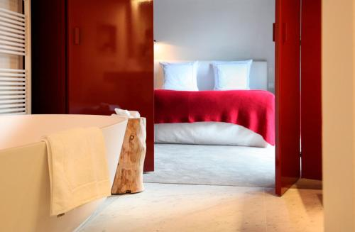 A bed or beds in a room at Hotel Julien