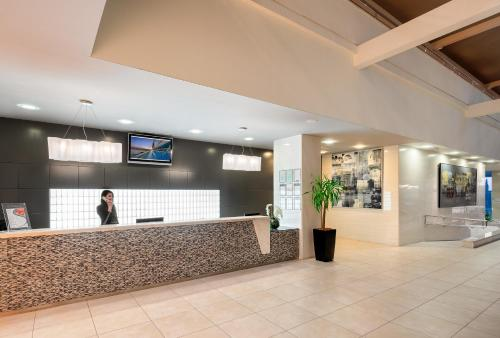 The lobby or reception area at Hotel Olympia