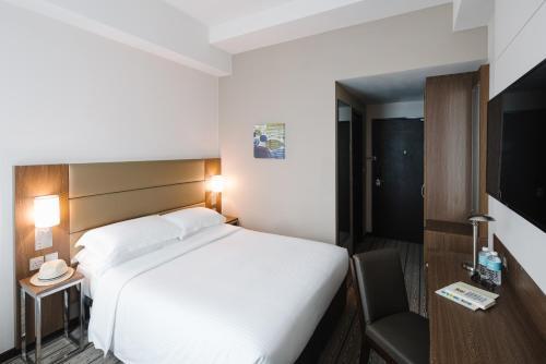 Ein Bett oder Betten in einem Zimmer der Unterkunft Hotel Traveltine