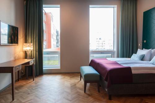 Un pat sau paturi într-o cameră la Apartments By Ligula, Hammarby Sjöstad