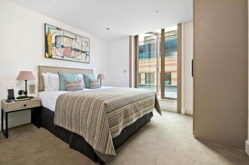 A bed or beds in a room at The Chronicle by Supercity Aparthotels