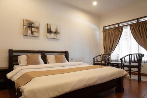 Tempat tidur dalam kamar di Toledo Inn