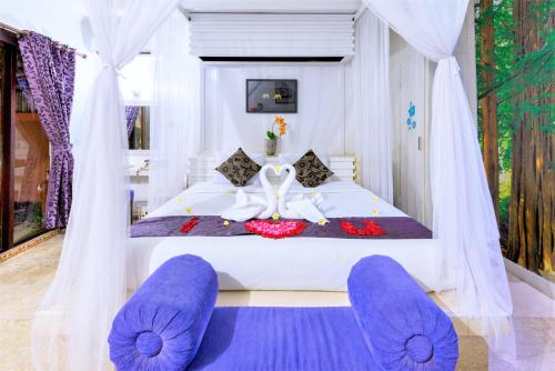A bed or beds in a room at Lavender Villa & Spa