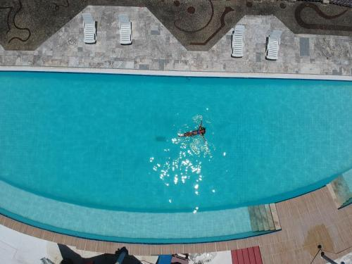 The swimming pool at or close to Flor de Lótus Hotel