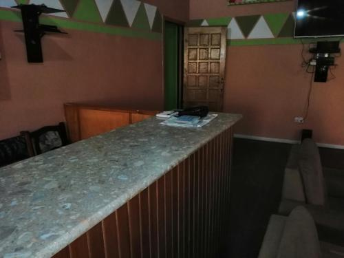 A kitchen or kitchenette at PANAASA GUEST HOUSE
