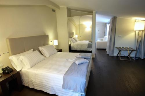 A bed or beds in a room at La Dimora del Baco Hotel
