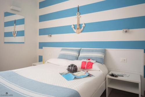 A bed or beds in a room at L'Approdo Dell'Ammiraglio