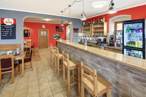 The lounge or bar area at Penzion Vladař