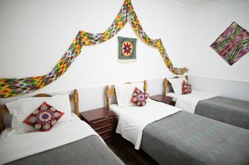 Cama o camas de una habitación en Trip.LE Guest house