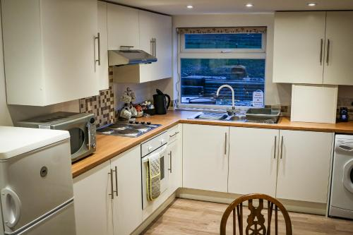 A kitchen or kitchenette at The Cottages Hamstall