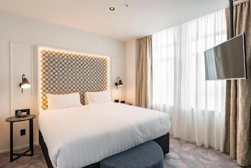 A bed or beds in a room at Airedale Boutique Suites