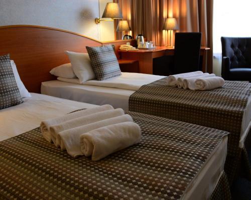 Un ou plusieurs lits dans un hébergement de l'établissement Hotel Orion Várkert