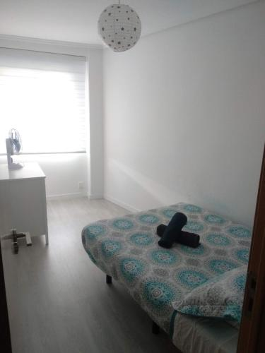 Cama o camas de una habitación en Mestre Valls Apartment