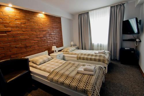 Łóżko lub łóżka w pokoju w obiekcie RJ Hotel