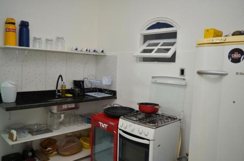 A kitchen or kitchenette at Pousada Divino Hospedagens e SPA